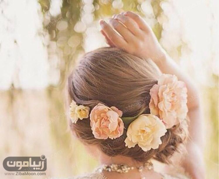 مدل مو عروس با گل طبیعی صورتی