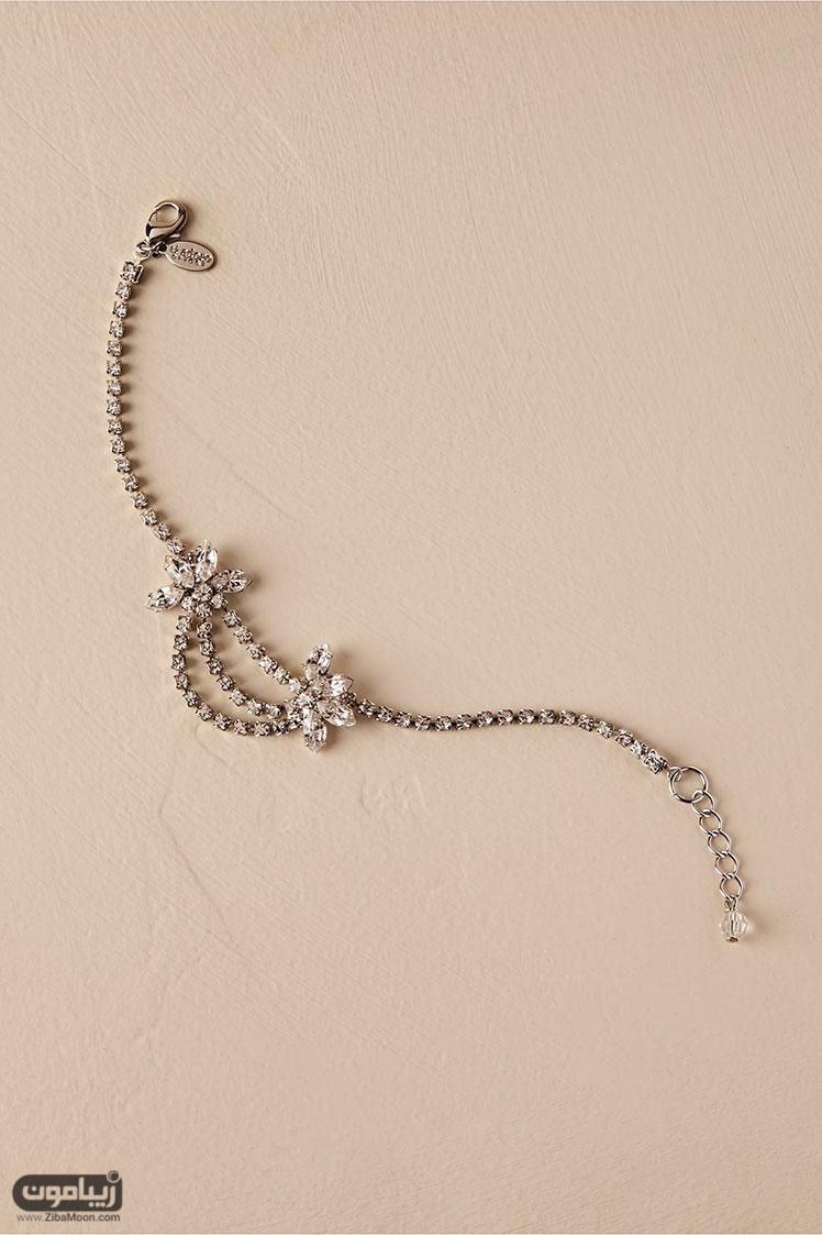 دستبند کریستالی گلدار و آویزی