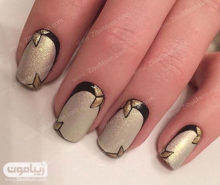 دیزاین ناخن با لاک اکلیلی طلایی