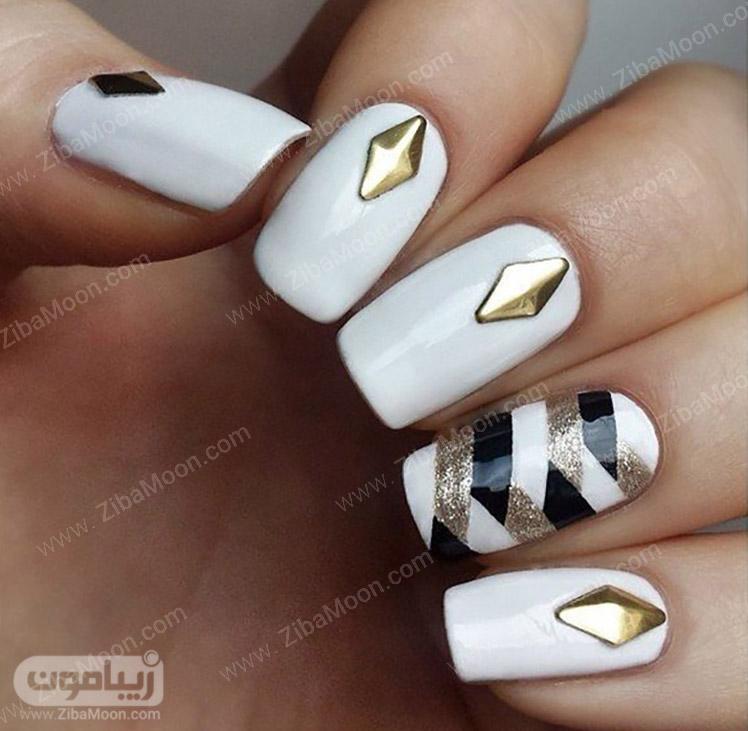 طراحی ناخن زیبا با لاک سفید و طلایی