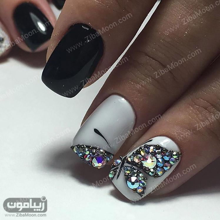 لاک سفید و مشکی و طرح پروانه کریستالی