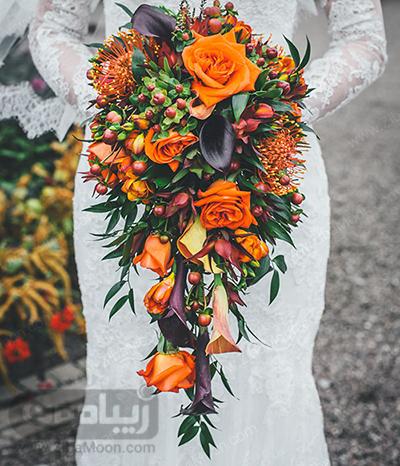 دسته گل عروس با گلهای نارنجی پررنگ