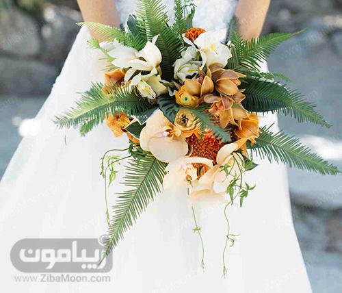 دسته گل عروس با گلهای نارنجی به رنگ نارنجی