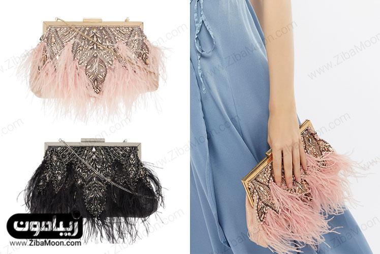 کیف دستی صورتی و مشکی با سنگدوزی و ریشه های آویزی