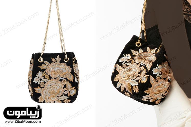 کیف دستی مشکی با گلدوزی طلایی و نقره ای و زنجیر طلایی