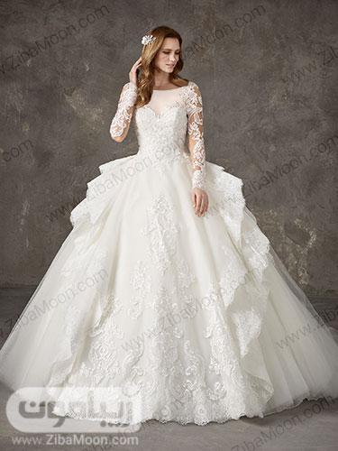 لباس عروس با دامن پرنسسی چند لایه گیپوری ابریشمی و کار شده با یقه دلبری