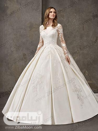 لباس عروس ساتنی با دامن پرنسسی و کار شده با منجوق و یقه دلبری