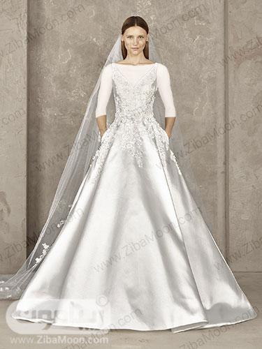 لباس عروس پرنسسی از ابریشم سفید میکادو و بالاتنه کارشده
