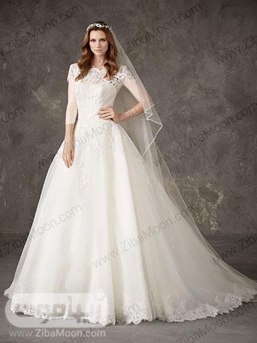 لباس عروس پرنسسی با بالاتنه کارشده و یقه قایقی و دامن لبه گیپوری