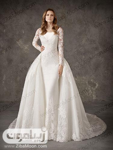 لباس عروس دوبل با دامن دم ماهی و دامن پرنسسی بالاتنه کاملا کار شده و دامن دور گیپوری