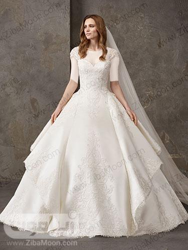 لباس عروس ابریشمی با دامن چند طبقه و آبشاری و منجوق دوزی شده