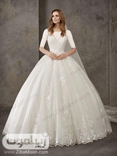 لباس عروس پرنسسی با دامن چند لایه توری و مروارید دوزی شده و گیپوری