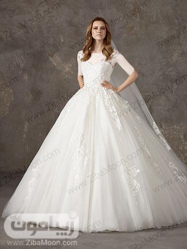 لباس عروس پرنسسی با دامن چند لایه توری و کارشده و بالا تنه ی گیپوری و منجوق دوزی شده