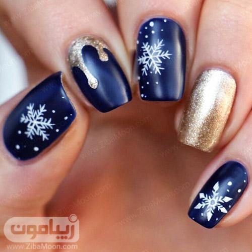 طراحی ناخن زمستانی شیک با لاک سورمه ای و طلایی