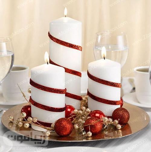 تزیین شمع سفید با ربان قرمز برای شب یلدا