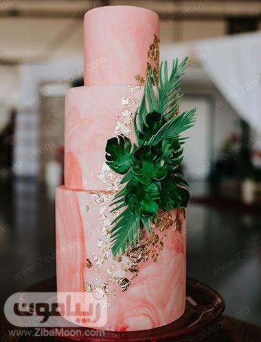 کیک عروسی ماربل مرجانی با تزین برگ سبز