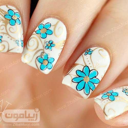 مدل ناخن گلدار دوست داشتنی با لاک سفید آبی طلایی