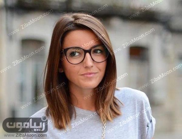 دختری با عینک فریم مشکی