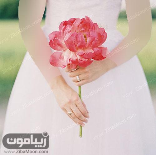 گل صورتی صدتومانی برای عروس