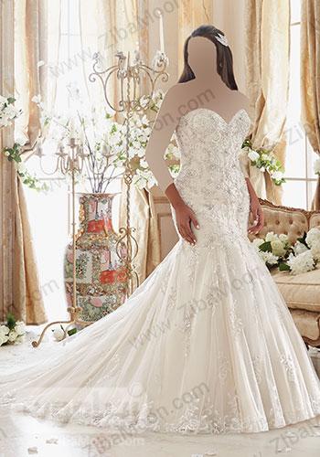 لباس عروس دم ماهی با دنباله بلند و بالاتنه کریستال دوزی شده