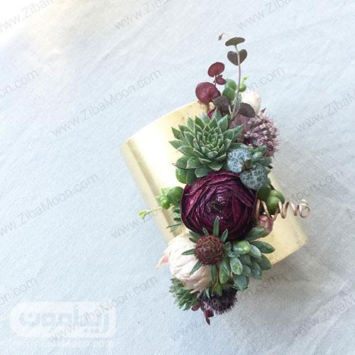 مچ بند گل عروس با گل صدتومانی ارغوانی و گل های سبز