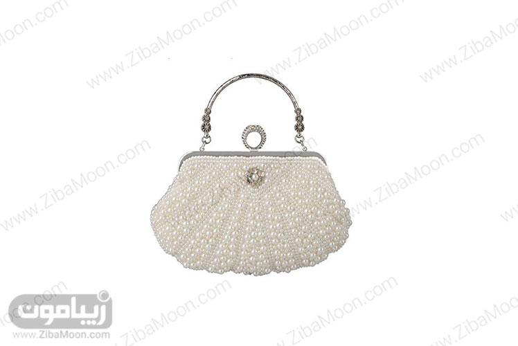 کیف عروس مروارید دوزی شده به شکل صدف