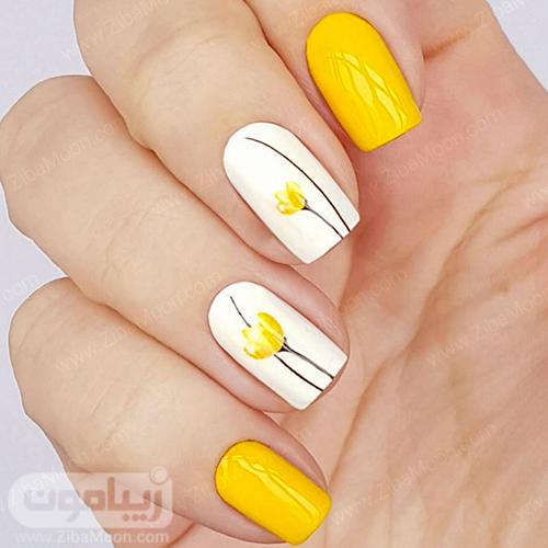 طراحی ناخن با لاک زرد و سفید و طرح گل زرد