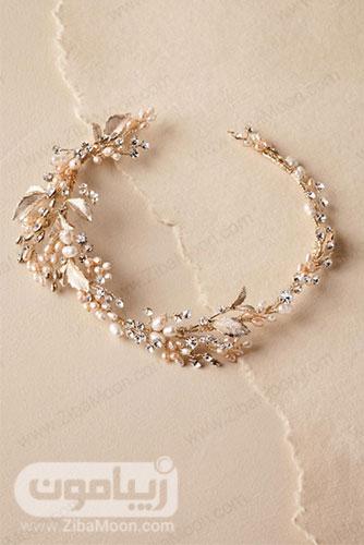 تل طلایی عروس تزیین شده با برگ های طلایی و گل های مرواریدی کریستالی 12