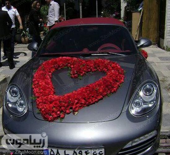ماشین عروس با گل قلب قرمز