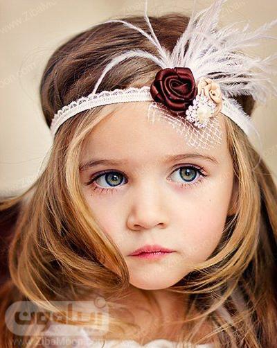 دختر بچه زیبا با هد بند شیک