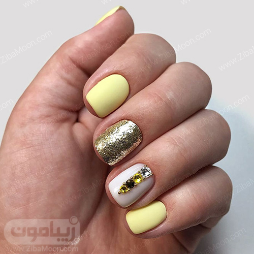 مدل ناخن زیبا با لاک زرد و سفید و طلایی