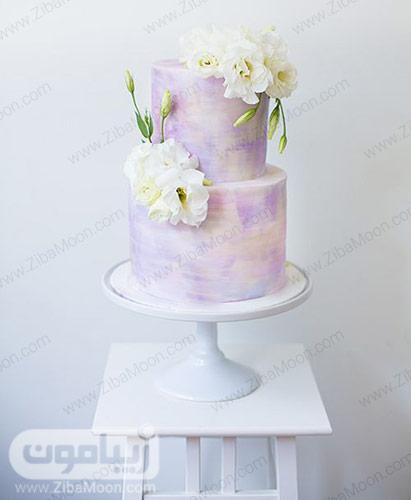کیک عروسی ابروبادی با تزیین گلهای سفید