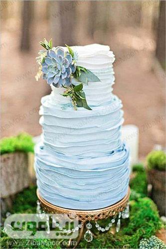 کیکی عروسی با تزیین باتر کریم آبی پاستیلی