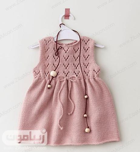 مدل لباس بافتنی دخترانه صورتی نوزادی