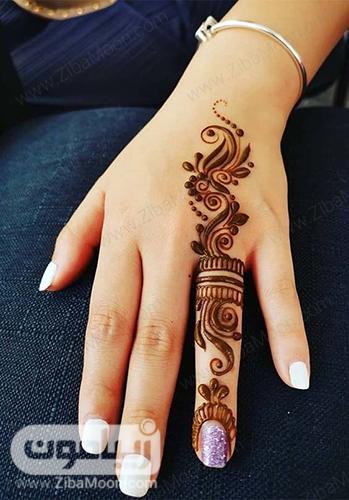 طراحی حنا زیبا و شیک روی انگشت دست