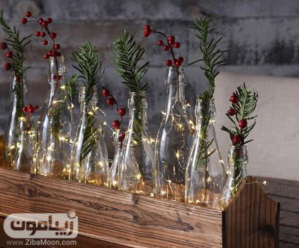 تزیین بطری های شیشه ای با برگ و گل قرمز