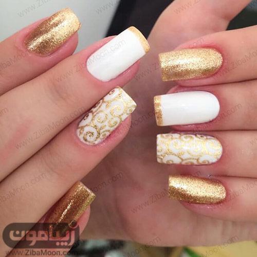 مدل دیزاین ناخن ظریف با لاک سفید و طلایی