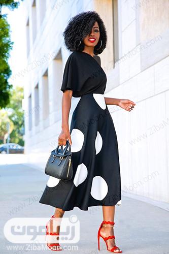 استایل زیبا با لباس مشکی و دامن مشکی با توپهای سفید و بزرگ
