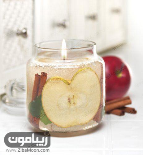ایده شمع آرایی با میوه های خشک