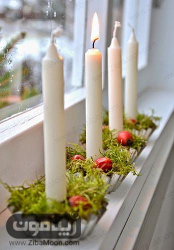 شمع پشت پنجره آشپزخانه