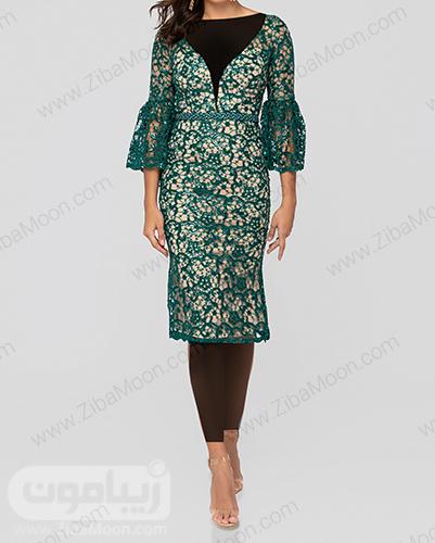 لباس مجلسی گیپوری به رنگ سبز با یقه هفتی شکل . آستین بلند و چین دار