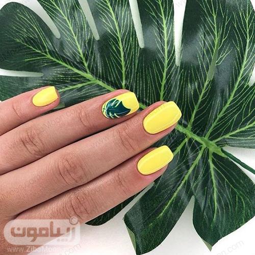 لاک ناخن زرد با طرح برگ سبز زیبا