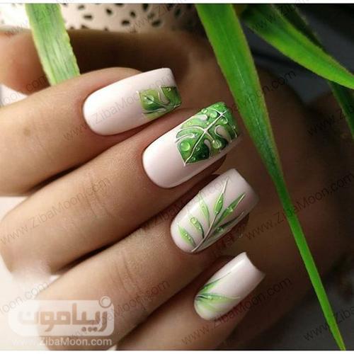 مدل ناخن با لاک سفید و طرح برگ سبز و شاداب