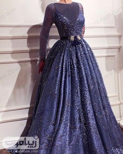 لباس مجلسی آستین بلند شیک و جذاب با دامن پف دار و پارچه درخشان به رنگ سورمه ای مخصوص نامزدی و حنابندون