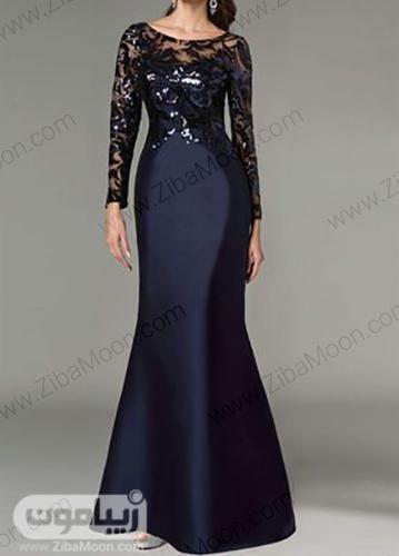 لباس مجلسی زنانه بلند و شیک به رنگ سورمه ای با بالاتنه درخشان و شیم