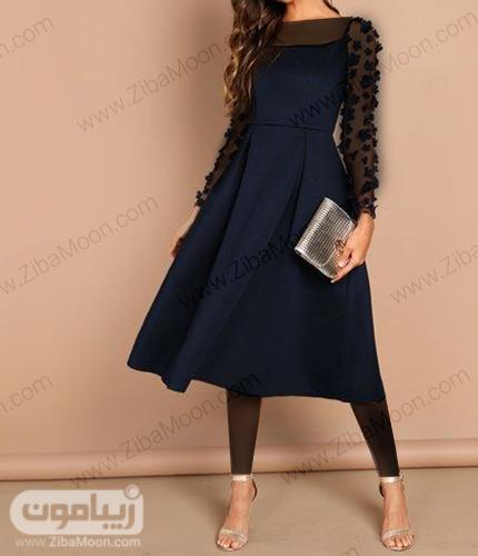 لباس مجلسی ساده و کوتاه دخترونه به رنگ سورمه ای با آستین بلند حریری و گل دار