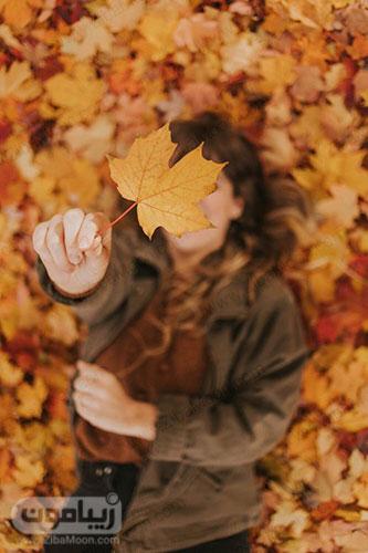 عکس پروفایل دخترانه زیبا با برگهای پاییزی