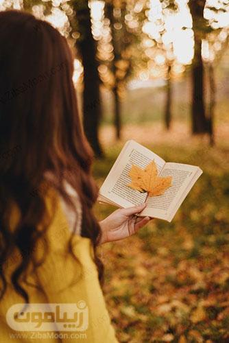عکس پروفایل پاییزی زیبا با کتاب و برگ پاییزی