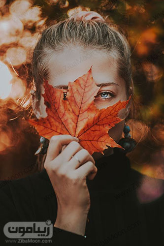 پروفایل دخترانه با برگ پاییزی روی صورت