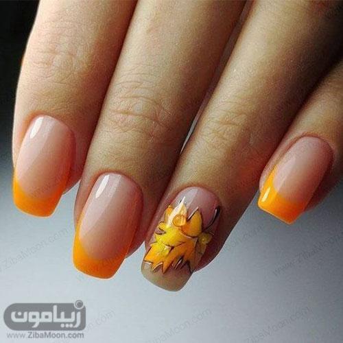 عکس فرنچ ناخن با لاک نارنجی و طرح برگ پاییزی